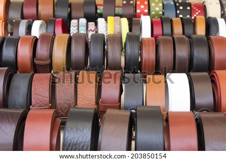 Set of different and colorful leather belts as a background