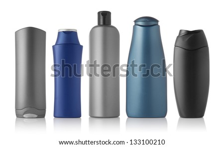 Set of different bottles for beauty, hygiene and health on a white background with reflection, they shampoo, conditioner and other hair products, each of them shot on separately. - stock photo