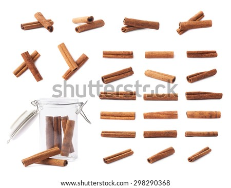 Set of different cinnamon sticks compositions isolated over the white background - stock photo