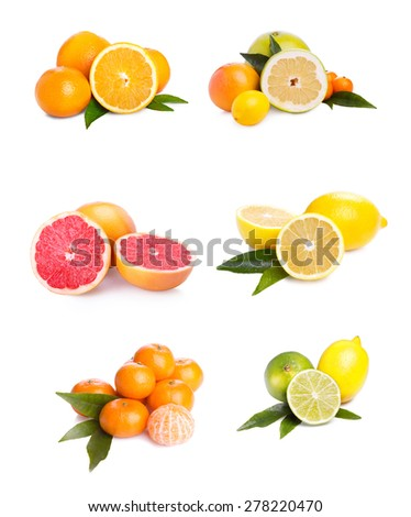 set of different citrus fruit and juice on white background - stock photo