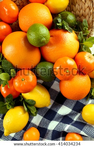 Set of different citrus fruit on tablecloth - stock photo