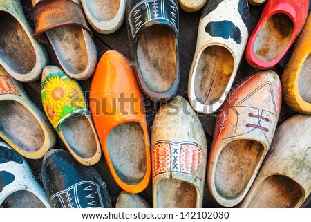 Set of different colorful vintage Dutch wooden clogs - stock photo