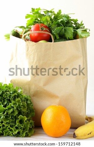 set of different convenience food (vegetables fruit) in a paper bag - stock photo