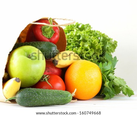 set of different convenience food (vegetables fruit) in a paper bag