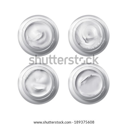 Set of 4 different cosmetics cream isolated on white