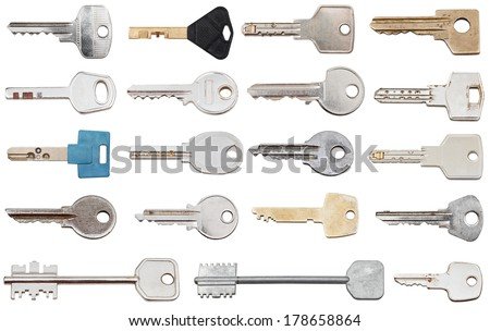 set of different door keys isolated on white background - stock photo