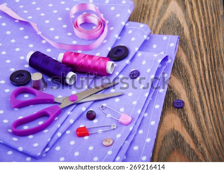 Set of different sewing accessories,fabrics and thread spools - stock photo