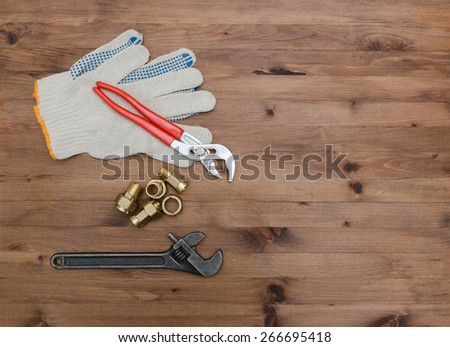 set of Different tools on a wooden background. - stock photo