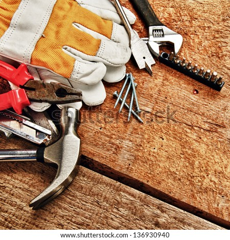 Set of different tools on wooden background - stock photo