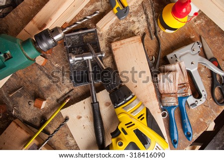 Set of different tools on wooden background