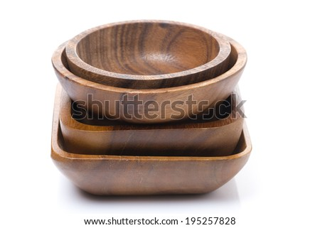 set of different wooden bowls, close-up, selective focus, isolated on white - stock photo