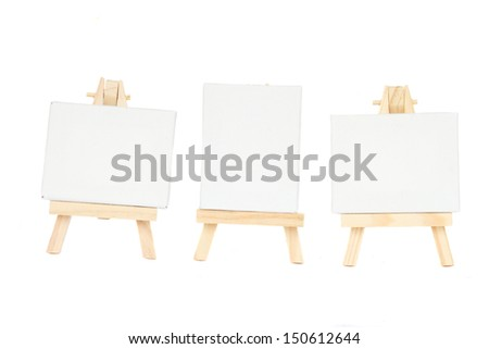 set of easels with blank canvas isolated on white background - stock photo