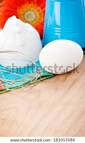 Set of Easter raw food on wooden cutting board with copyspace - stock photo