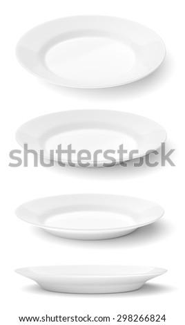 Set of empty ceramic round plates isolated on white background - stock photo