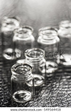 Set of Empty little bottles with black leather background, Sensitive Focus