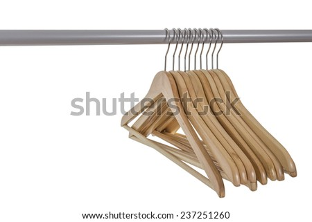 Set of empty wooden hangers on a rack, isolated on white background - stock photo