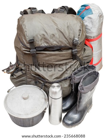 set of expedition equipment with backpack, tent, pot, rubber boots, thermos, gas burner isolated on white background - stock photo