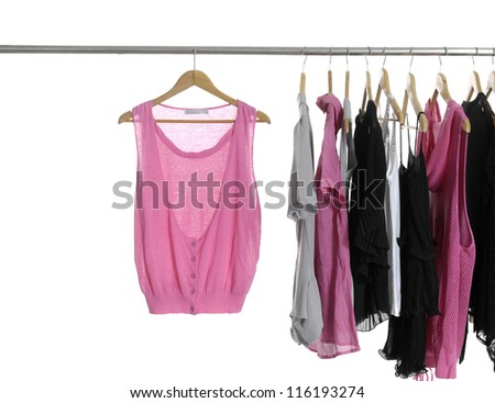 Set of fashion clothing on hangers at the show - stock photo