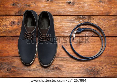 Set of fashionable man's accessories on brown wooden background - stock photo