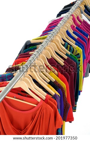 Set of female colorful clothes on Hangers - stock photo