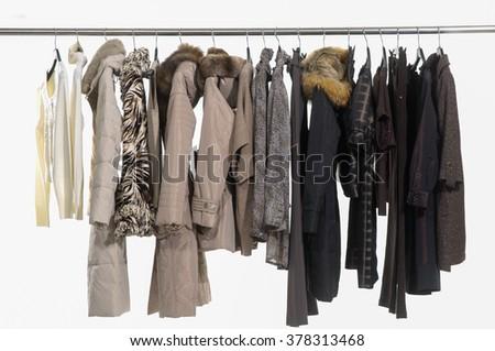 Set of female dress with,coat isolated on hanging  - stock photo