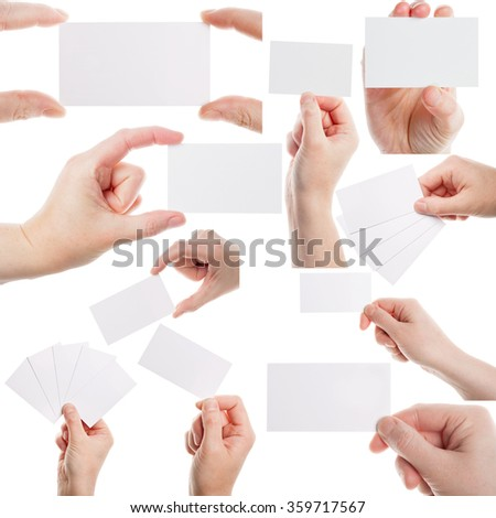 Set of female hands holding business cards isolated on white background