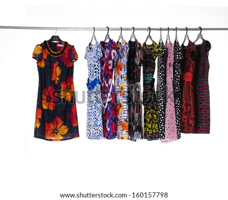Set of female sundress clothes hanging on clothes rack  - stock photo