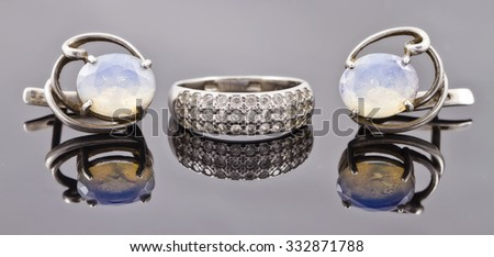 set of fine silver jewelry : ring and earrings with moonstone - stock photo