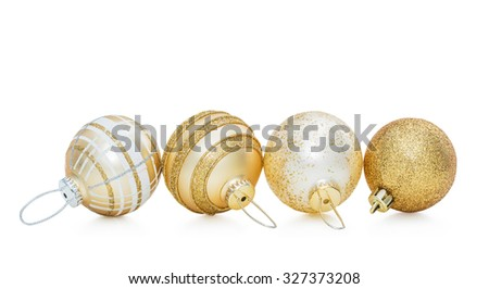 Set of four gold Christmas ball and New Year baubles decoration isolated on white background - stock photo