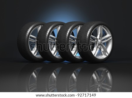 Set of four luxury car wheels on black reflective background - stock photo