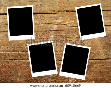 set of four old blank frames lying on a wood surface