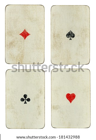 Set of four vintage ace playing cards with dirty grimy surfaces and simple designs isolated on white - stock photo