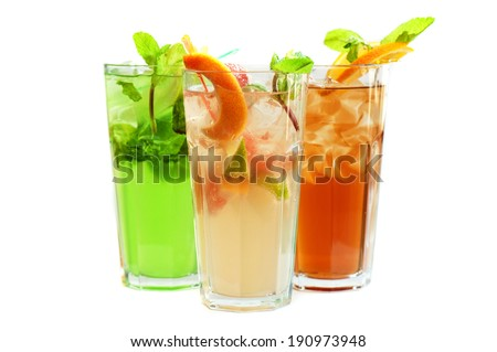 Set of fresh cold tea with fruits, berries and ice on white - stock photo