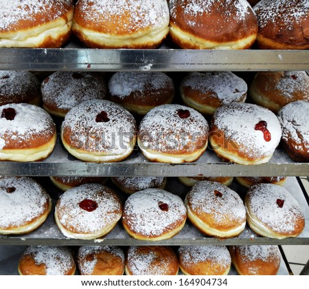 Set of fresh donuts for Hanukkah - Jewish traditional holiday  - stock photo