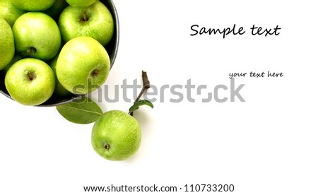 Set of fresh green apples in metallic bowl isolated on white background with copy space - stock photo