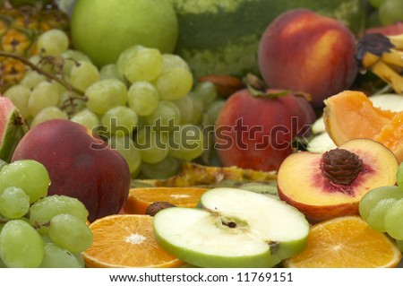 set of fresh healthy fruits on green background
