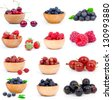 set of fresh strawberry, Blueberries, Raspberries, cherry, gooseberries and blackcurrants in a wooden bowl, over a white background. - stock photo
