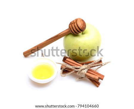Set of fruit, tied cinnamon sticks, honey and wooden spoon. Composition of apples and spices, close up. Apples, cinnamon and honey isolated on white background. Eco shopping and summer crops concept.