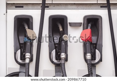 Set of fuel pump nozzles. - stock photo