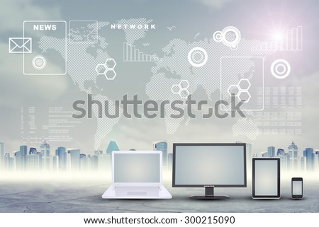 Set of gadgets on city background with world map - stock photo