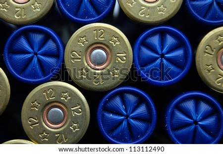 set of game cartridges for hanting, concept of good team for business (team work). Shotgun cartridge of 12 gauge, rifle ammo - stock photo