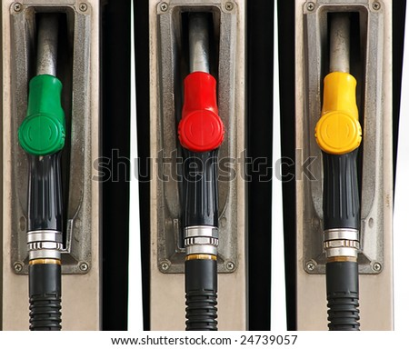 set of gas pump nozzles - stock photo