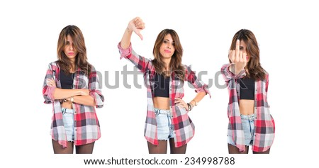 Set of Girl doing a bad signal over white background - stock photo