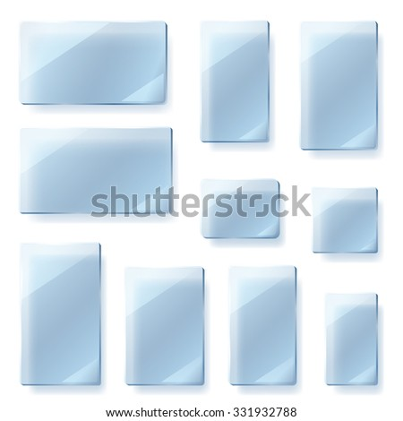 Set of glass plates of different shapes in light blue colors - stock photo