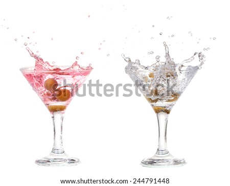 Set of glasses with martini.  Splash from olive in a glass of cocktail, isolated on the white background, clipping path included. - stock photo