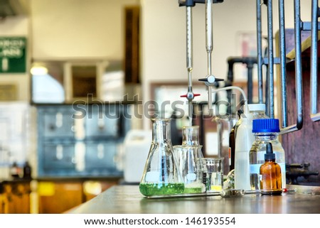Set of glassware in chemical lab. - stock photo