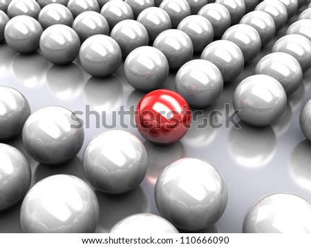 Set of glossy grey balls with red ball in the middle