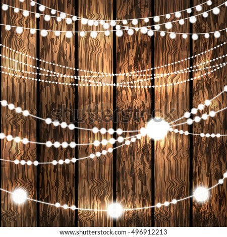 Set Of Glowing String Christmas Lights For Xmas Holiday Greeting Cards Design On Wooden Background