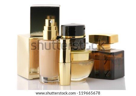 Set of gold cosmetic products isolated on white background. - stock photo