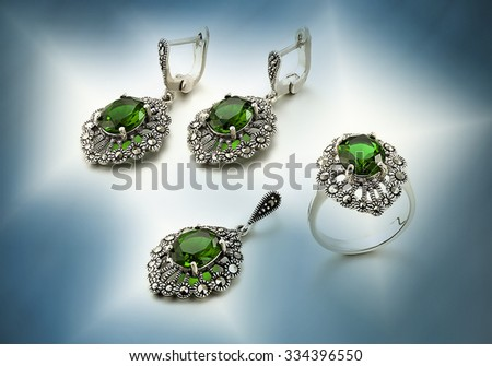 Set of gold jewelry with emerald - stock photo